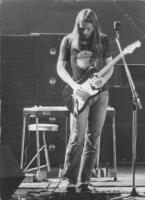 Dave Gilmour utilising his Fender Stratocaster and well trimmed beard with Pink Floyd!