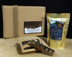 Small Jamaican Blue.    One of our most popular gifts, the small Jamaican Blue comes with a full 16oz of 100% Jamaica Blue Mountain coffee, and then we add a 7 oz box of assorted chocolates from the Chamberlain's Chocolate Factory.  To top it off we include a 5 oz box of decadent truffles. Price $60.00