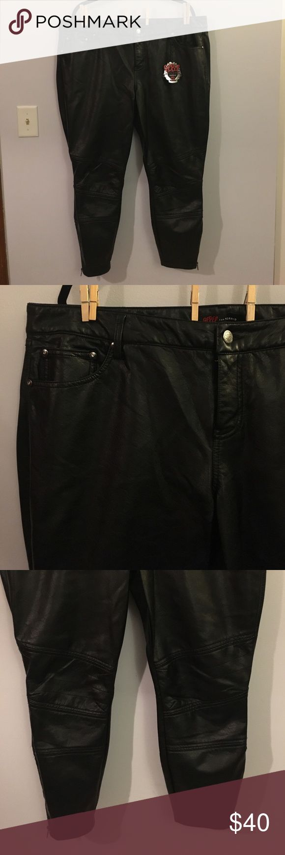 "Rebel Wilson for Torrid Black Faux Leather Pants Up for grabs is this pair of pants from Rebel Wilson for Torrid. They are a size 20 and have a 27"" inseam with a 42.5"" waist and 51"" hips. These pants are skinny pants style in black faux leather. They feature moto style patches, rhinestone accents and zip ankles. These skinnies are new with the original tags. torrid Pants Skinny"