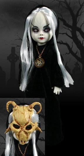 "Living Dead Dolls German Exclusive Walpurgis Date of Death: 30/04/779 A.D. ""Wearing the mask of a goat, Raising demons she invokes. To the flames they all flock, Mitten in der Nacht"" Death Certificate: ""Upon Mount Brocken, the Harz highest peak, Witches, demons and the dead gather to meet. They come to dance and celebrate in haunted disarray, And our sweet little Walpurgis leads the way."""