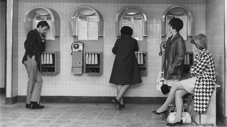 Customers use the newly installed telephones at the Oxford Circus station in 1968 (Credit: Credit: Tim Graham/Fox Photos/Getty Images)