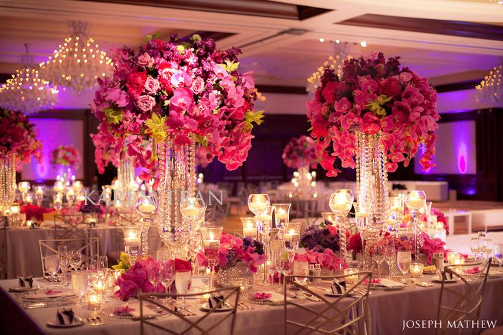 Rich grape, hot pink, light pink and electrix green floral palette + chandeliers.