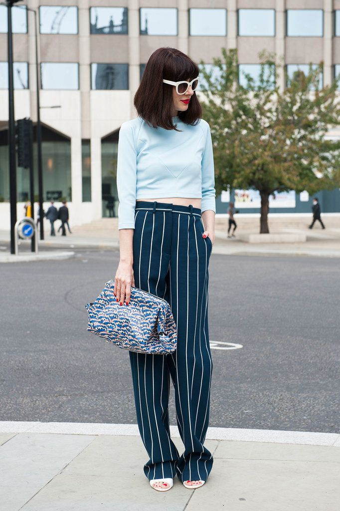 Best #streetstyle @ Spring 2015 Ready-to-Wear #LFW | a light blue crop top paired with a striped navy blue oversized trousers, white ankle strap sandals and a printed oversized clutch