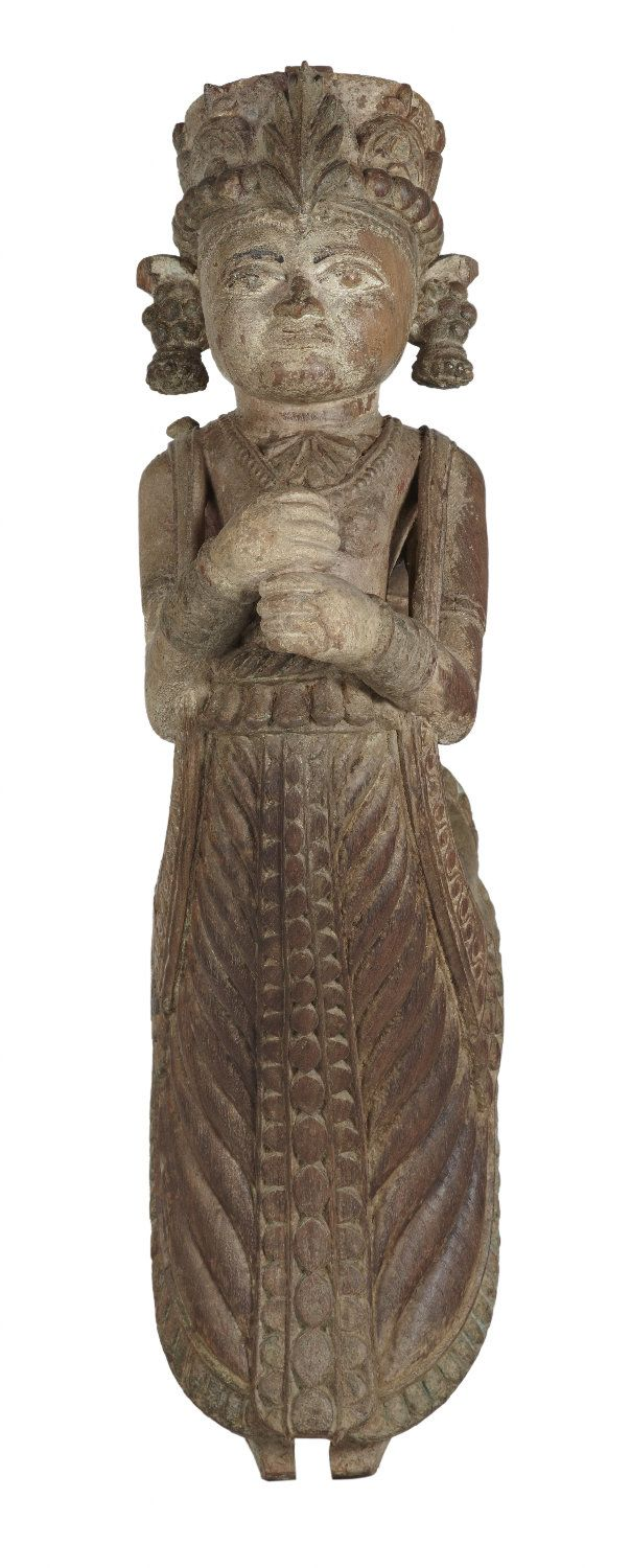 This carved wood female musician holding a a disc like  musical instrument, originally a strut from a pillar of a wood mansion from north-western India. The figure can be identified as #apsara, the divine dancer and musician of Indian Mythology.#Gujarat, #19thCentury