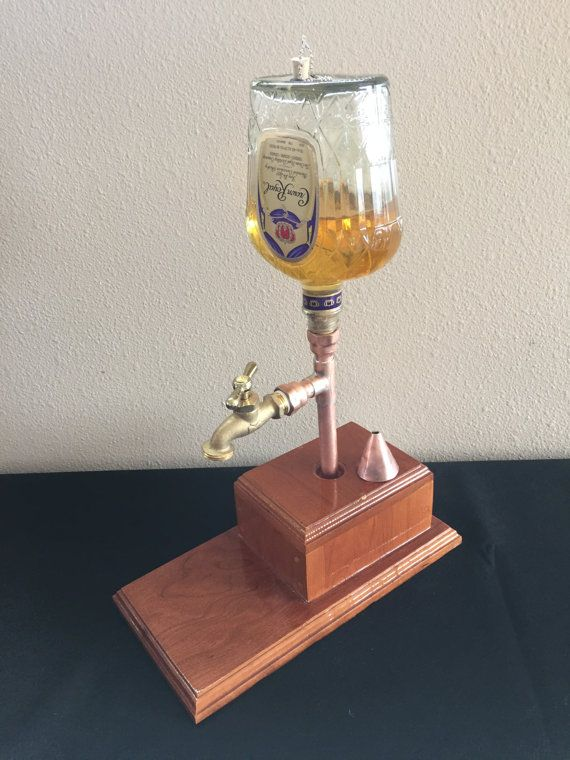 This is a unique liquor dispenser hand made of soldered copper pipe and fittings, with a nice hand made base made of pine and a nice lacquer