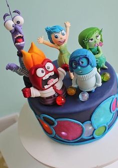 Inside Out Cake Buy small figures and put on cake, easy peasy