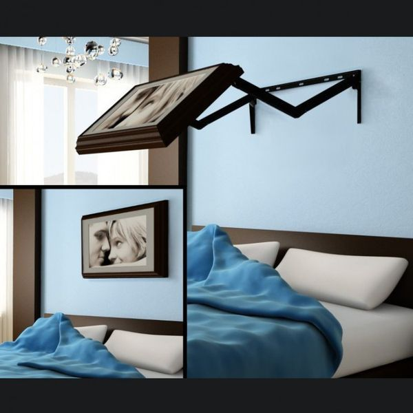 brilliant idea for a TV mount in the bedroom.Picture frame on the outside TV  on the inside.That is awesome!