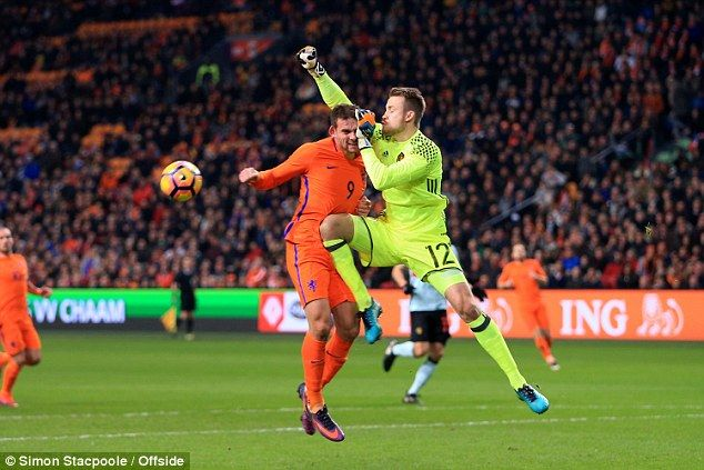 Vincent Janssen picks up a head injury in a clash with Liveprool goalkeeper Simon Mignolet