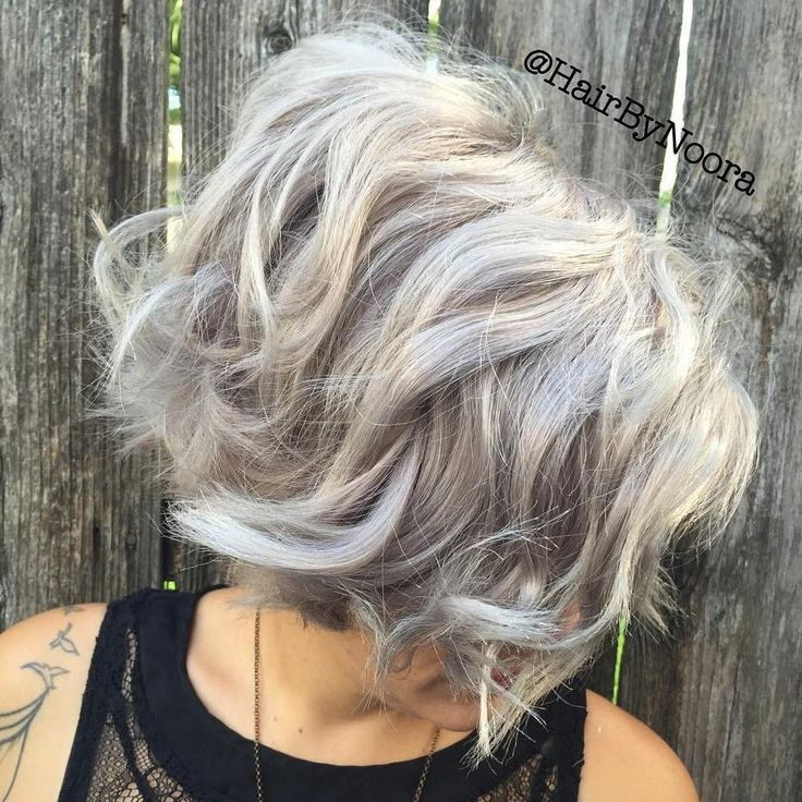 Beach Waves for Bob  The perfect waves for short hair are bouncy and fun. To get this look, use a large barrel curling iron on the top layers of the hair. Next you'll want to break up the curls and tease the top and back of the hair to create volume.