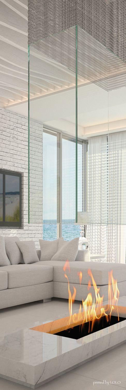A luxury modern fireplace for your living room design #winterdecoration #moderninteriordesign #homedecorideas See more inspirations at www.homedecorideas.eu