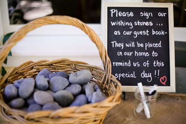 18 Totally Unique Memorial Service Guest Book Ideas - signed river stones instead of guestbook.