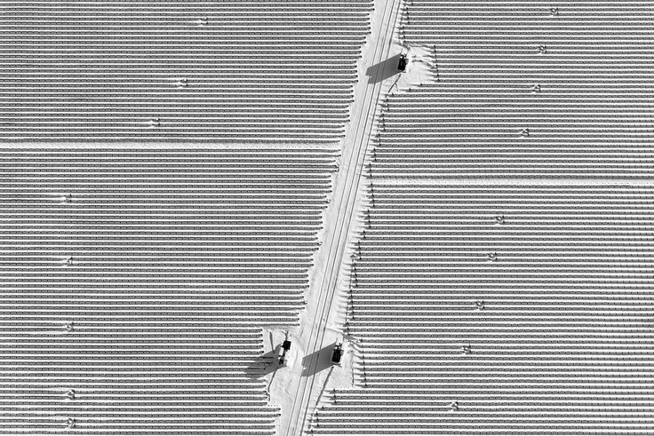 In my search for repetitive patterns I stumbled across this solar farm in Lawrenceville, New Jersey. It wasn't generating much electricity when I took this photograph. There were several days of warmer weather until the snow fully melted. (3788)