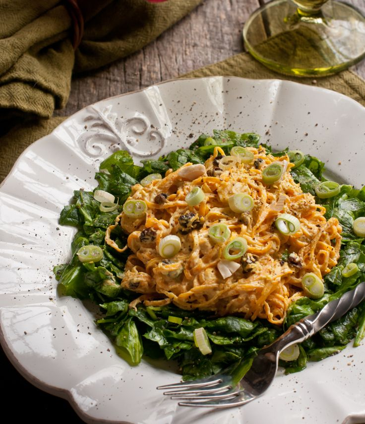 Raw Curried Squash Noodles on Spinach —Rawmazing Raw Food