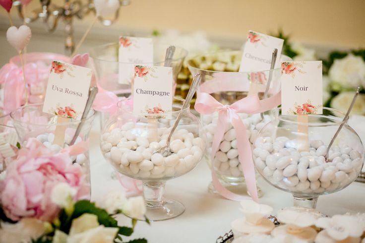 A sumptous table with Italian confetti for a romantic wedding in Villa Geno, on the shores of Lake Como.    #destinationwedding #destinationweddingplanner #elenarenzi #lakecomoweddings #myjob #mypassion #luxury #luxuryevent #luxurywedding #luxuryvilla #luxuryvenue #villageno #lakecomo #como #italy #bride #groom #beautifulcouple #confetti #dragees #champagne  #tasteful #pink #white #chocolate #happiness #love #beauty #elegance #refinement