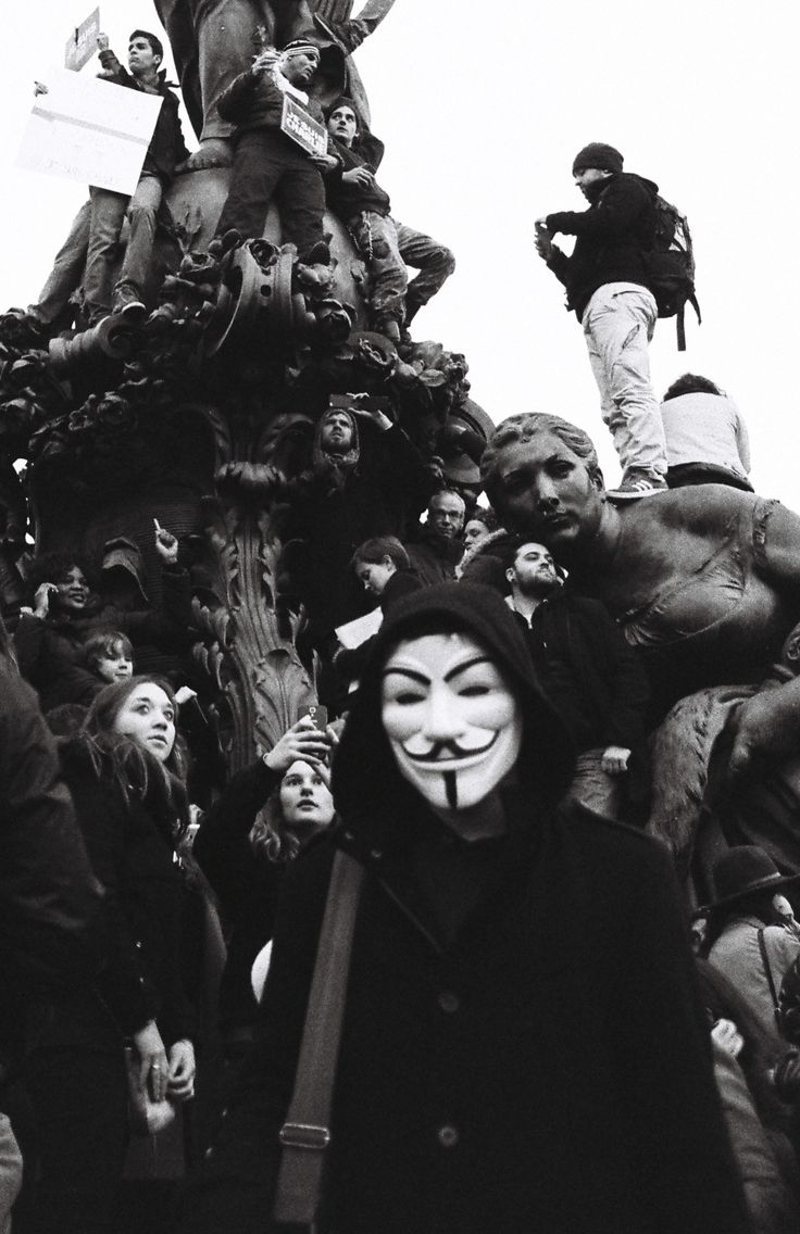 A covered citizen stares at the camera during a french demonstration in support of Charlie Hebdo, January 11th, Paris  | Credit : Ryan Burton | Pentax K1000, 35mn, f=8, 1/500, HP5+ film