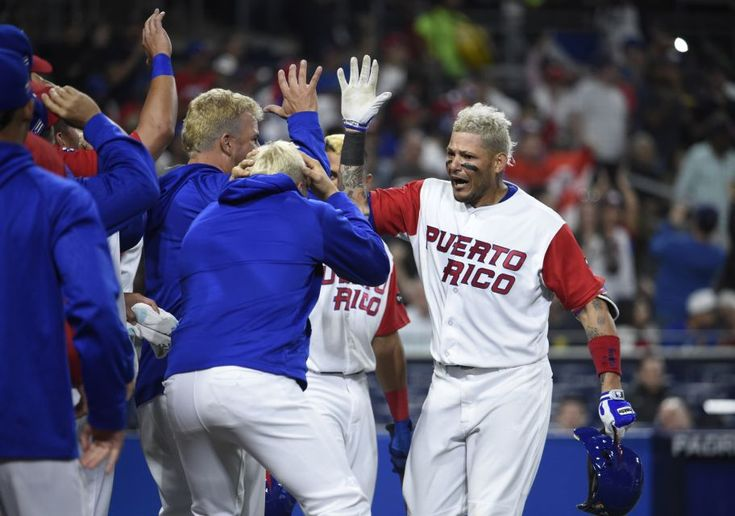 Yadier Molina #4 of Puerto Rico, right, is congratulated after hitting a solo home run during the sixth inning of the World Baseball Classic Pool F Game One between the Dominican Republic and Puerto Rico at PETCO Park on March 14, 2017 in San Diego, California.