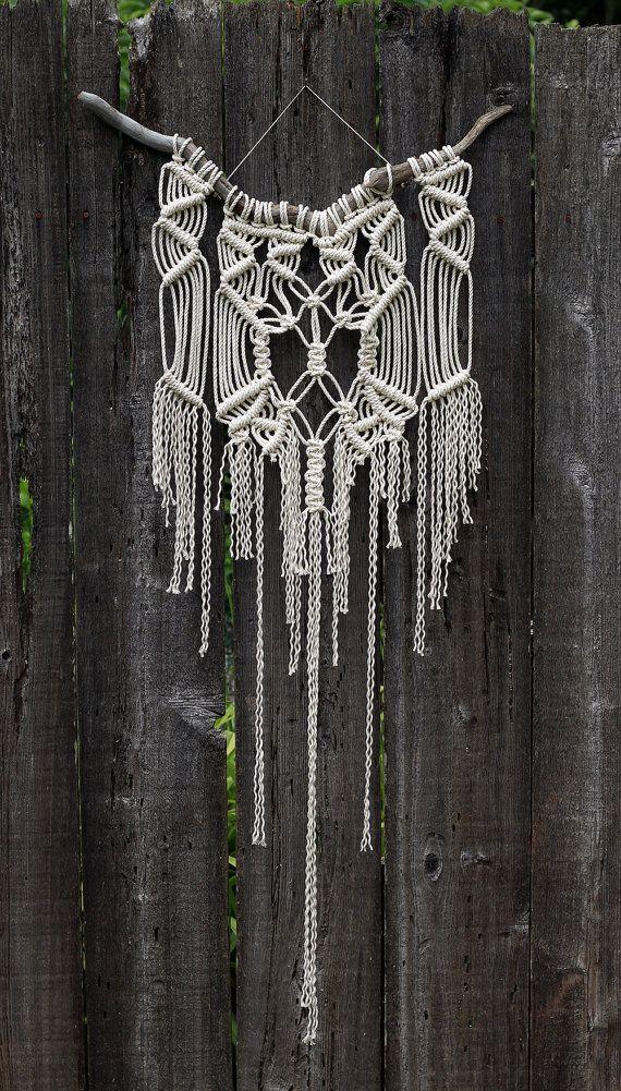 White macramé wall hanging on drift wood