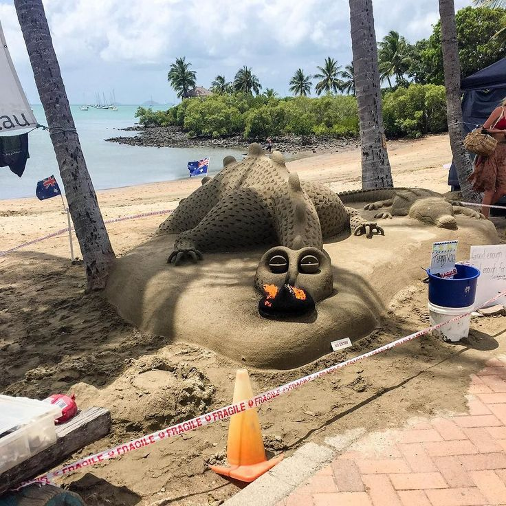 Found ol' Smaug at Airlie Beach hoarding tourist gold  #therebedragons #dragonsbreath #sandsculpture #whitsundays