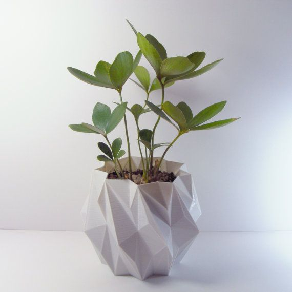 A 5 Inch Tall (12.7 cm) EleMental Geometric Planter  Enjoy the potential of fresh & modern art in your life with this planter. It features a futuristic