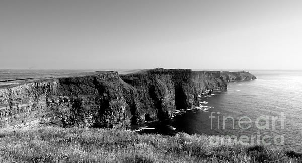 'Cliffs Of Moher' A black and white shot of the Cliffs of Moher on the west coast of Ireland. These cliffs are located not far from the small village of Doolin in County Clare, Ireland. They rise 120 metres (390 ft) above the Atlantic Ocean and reach their maximum height of 214 metres (702 ft). These cliffs are not the highest in Ireland, but they are definately the most spectacular. #cliffs #ireland #cliffsofmoher