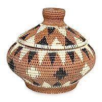 http://www.novica.com/itemdetail/index.cfm?pid=96128  Palm leaf basket, 'Diamonds on Brown'         Delicate diamonds in cream and black enhance the textured curves of this graceful brown basket. Using completely natural resources, Desak Putu Rai weaves it by hand from Indonesian lontar (palm leaf). The colors are achieved with organic dyes – brown from clay and black from teak leaves.   An artisan story card will be included with your purchase.  37.95