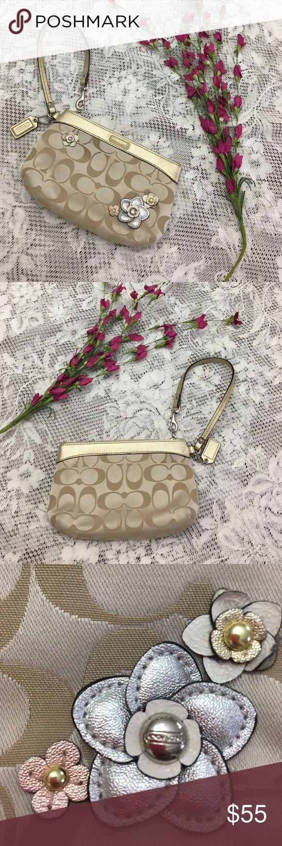 ⭐️Gold Signature Flower Appliqué Coach Wristlet Authentic Coach Signature Floral Applique Medium Wristlet!  This piece is so pretty and feminine. It's big enough to hold a iPhone 6 Plus! Its big! This features: Signature fabric with floral applique details and leather trim * Interior Pink Sateen Fabric * Interior slip pocket. * Zip top closure with dogleash clip. Coach Bags Clutches & Wristlets