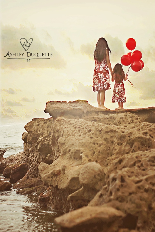 the beach, the RED balloons, holding hands, and mother daughter