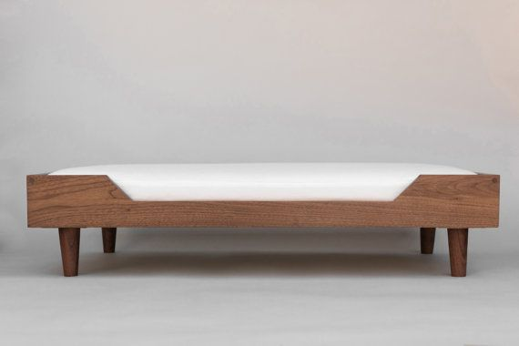 The Winston bed was designed to perfectly complement every interior space. With warm wood tones and neat, clean lines, it offers a stylish alternative to its oddly-colored, overstuffed brethren. Details:  Handmade, solid hardwood construction. Hardwood boards are all hand-selected and screened for defects. High quality foam cushion with a premium fabric cover which can be easily removed and washed.  Bed Sizing:  Small: 18 W x 24 L x 8 T Medium: 20 W x 30 L x 8 T Large: 24 W x 36 L x 8 T  We…