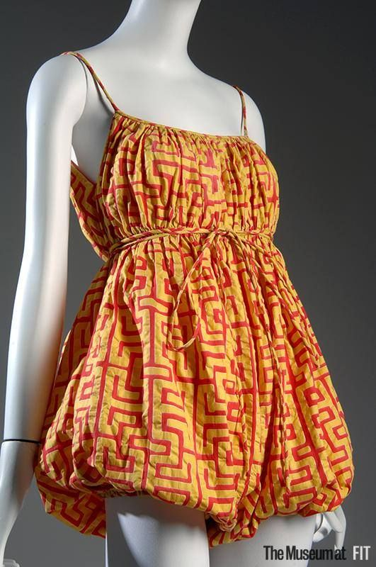 Claire McCardell romper with fabric designed by Nina Lewin, Resort 1952-1953. From the collection of The Museum at FIT. #5womenartists  This romper was a promotional collaboration between McCardell, Everfast fabrics, and a Latin American tourism company.