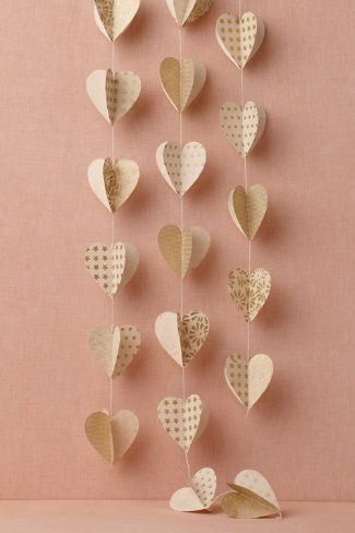 Heart of Gold Garland (3) from BHLDN, Paper items can keep costs down and add a great deal of added great finishing touches!  These 3 dimensional gold gilded hearts garlands are from Nepal made from Lokta paper.