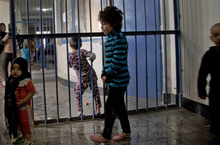 Children walking through the prison. 62 children live with their imprisoned mothers in the jail.