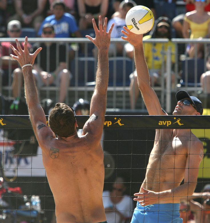 (Rick Egan  | The Salt Lake Tribune)   Phil Dalhausser hits the ball, as  Ryan Doherty defends, in the men's finals of the AVP Volleyball tournament at Liberty Park, Sunday, August 18, 2013