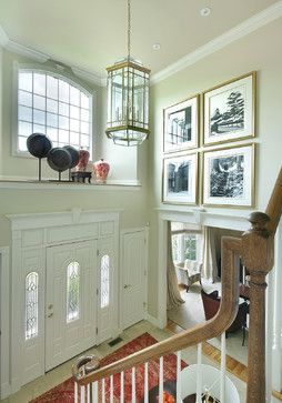 Shelf above front door (but use different decorative objects), grouping of large artwork to fill tall walls above doorways.