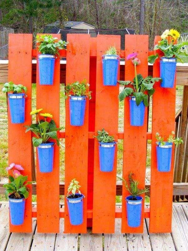 vertical herb garden pallet herb garden orange paint blue flower pots