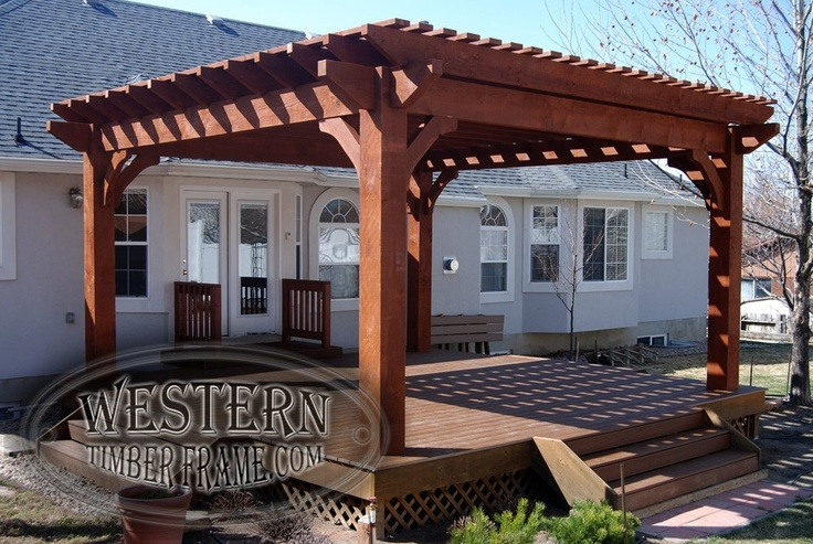 Free standing pergola with Rich Sequoia stain and Axis profile. Trex deck and stairs and timber handrails.