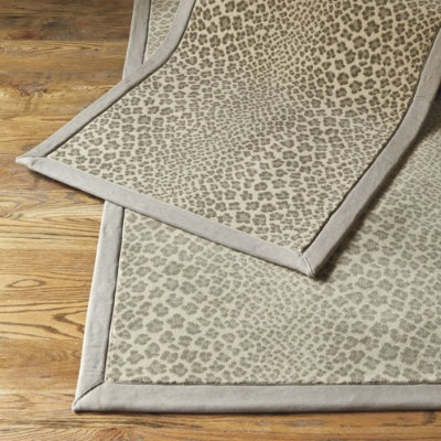 Panthea Rug Animal prints have evolved from occasional accents to home fashion must-haves. Machine woven of durable 100% polypropylene with a soft gray cotton twill border. Corners are mitered for a crisply finished look. Runner for hallway?