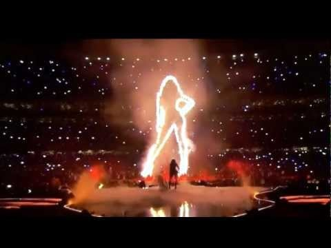 """Grammy-winning Beyoncé flaunted her supreme vocal & dancing chops throughout the 2013 Super Bowl XLVII Halftime show in the New Orleans' Superdome. Mrs. Carter unleashed a medley of her best tunes – including older hits like """"Crazy in Love"""" (sans her husband, Jay-Z), """"Halo"""" & """"Baby Boy,"""" & more recent cuts like """"Love on Top"""" & """"End of Time"""" – decked out in an oversized black jacket, lace-and-leather bodysuit & thigh-high stockings."""