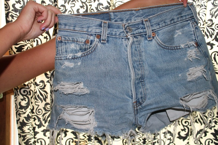 A poor college graduate trying to stay caught up with the latest trends by going to Goodwill and playing clothes doctor.  DIY high-waisted shorts, ladies.