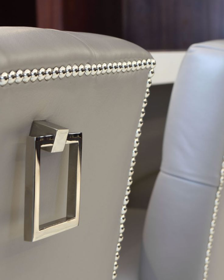 Studded upholstery and handle