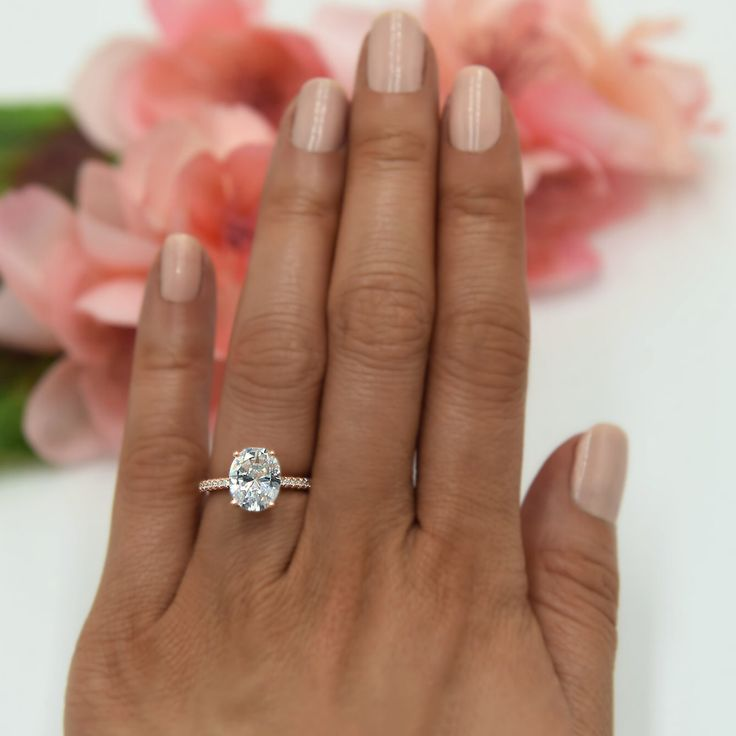 3.25 ctw Oval Accented Solitaire Ring, Blake Engagement Ring, Bridal Ring, Man Made Diamond Simulants, Sterling Silver, Rose Gold Plated by TigerGemstones on Etsy https://www.etsy.com/listing/483227516/325-ctw-oval-accented-solitaire-ring