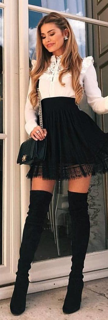 #winter #outfits black mini skirt and pair of black knee-high boots