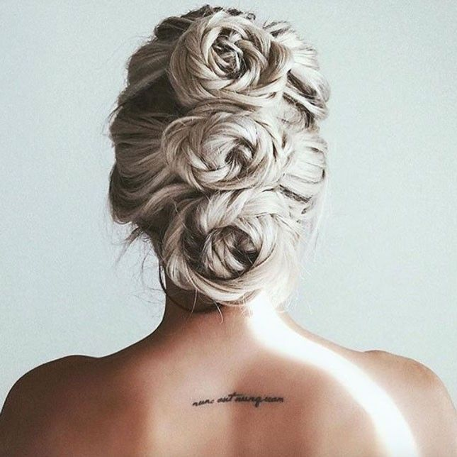 Twist 3 loose rope braids into a line of buns to achieve this triple rose chignon hairstyle.