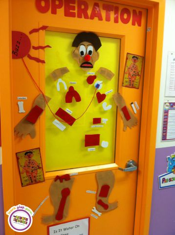 What a fun way to decorate the center! Each classroom is a different board game theme!