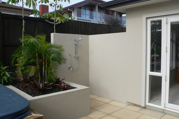 Outdoor shower in corner of pool & spa enclosure. Designed by Fusion Lsandscape Design. www.fusionlandscapedesign.co.nz