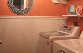 mirror in small laundry room! - orange laundry room makeover