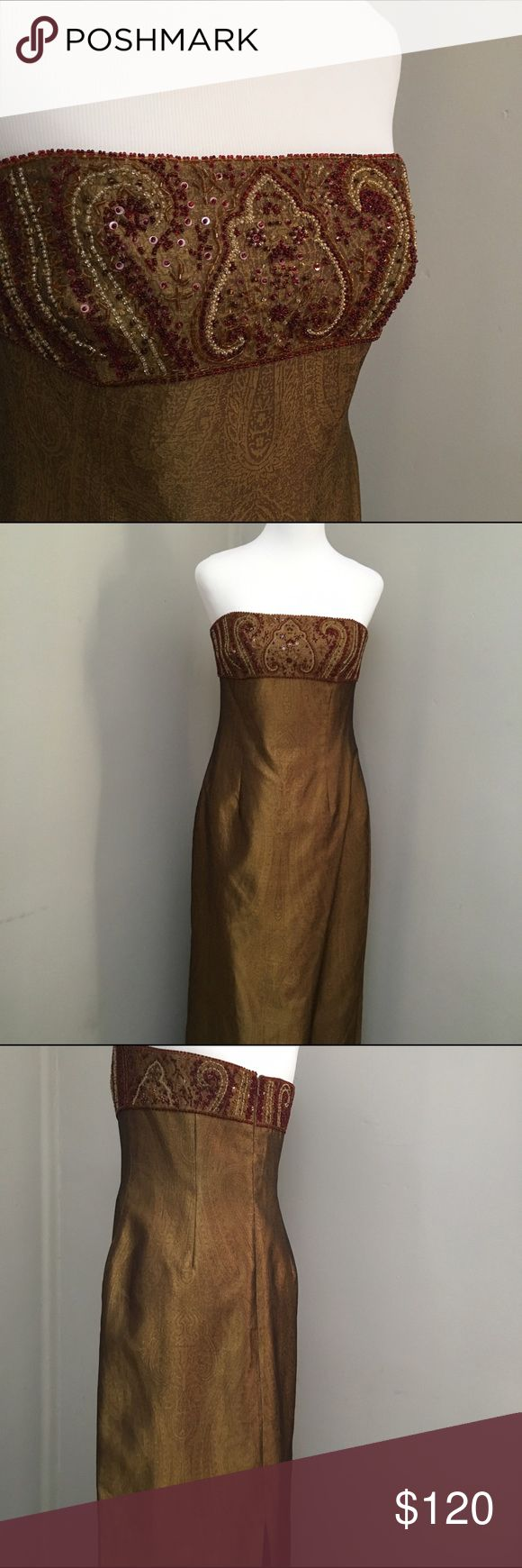 Kay Unger Formal Brocade Gold Gown This Kay Unger full length formal gown is made from beautiful textured gold silk. It is strapless and has rich red and gold beading and sequins. The back has a slit. Size 10. Kay Unger Dresses Strapless