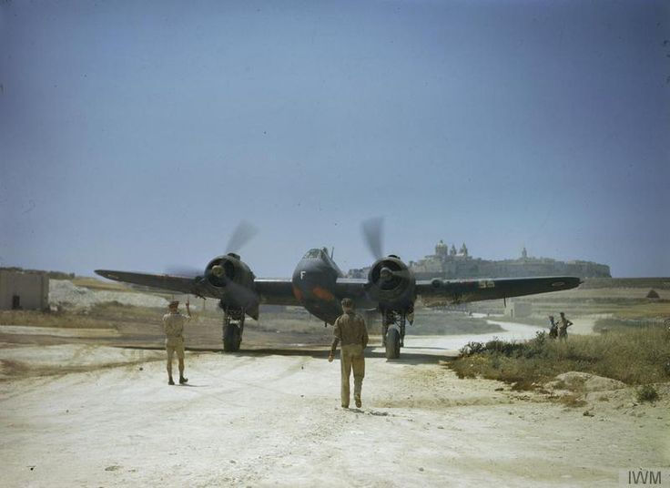 With Mdina in the background, Bristol Beaufighter Mark VIF 'F-Freddie' of No 272 Squadron, Royal Air Force on the taxiway at Ta Kali, Malta. June 1943.