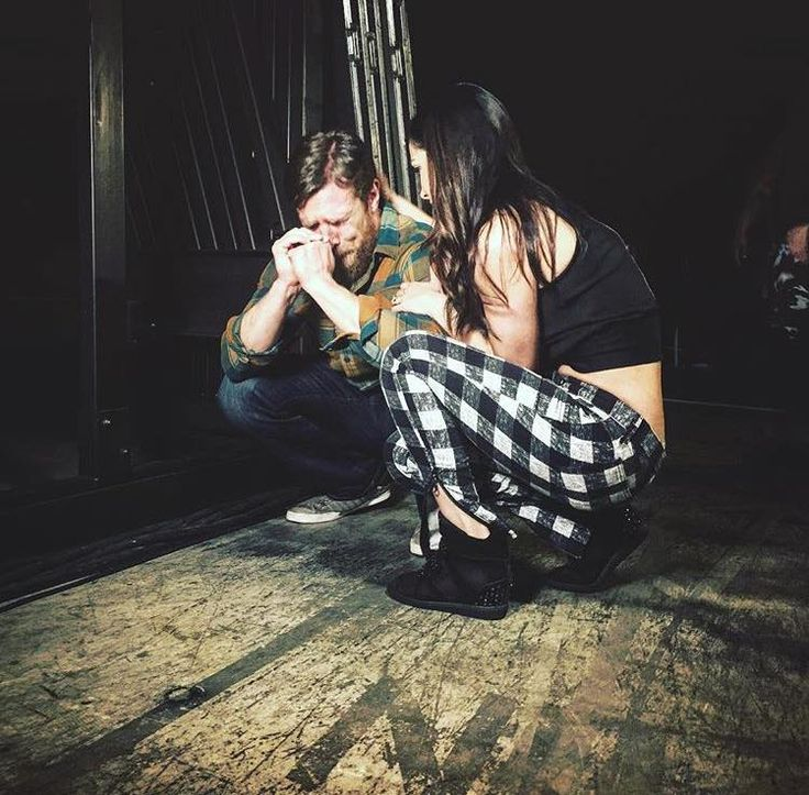 WWE's Daniel Bryan and his wife backstage moments after he announces his early retirement due to concussions