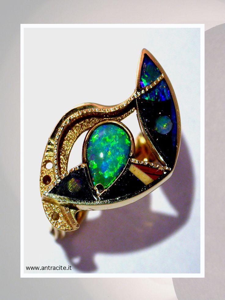 Aquary - ring in yellow gold 750/1000, inlay of opal and semi precius stone, australian opal