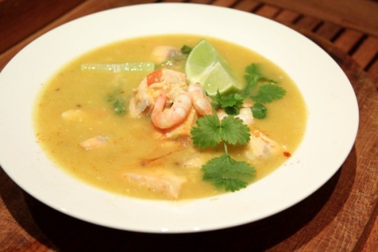Yellow tomato soup with fish, herbs and prawns. - Gul tomatsoppa med fisk och räkor